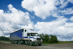 Truck riding on road Royalty Free Stock Image