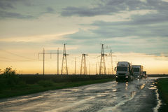 Truck riding on wet road. Under storm sky Stock Images