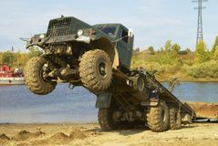 Truck and river pontoon. Truck pulling pontoon element from river stock photos