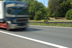 Truck on the road. Heavy truck moving with high speed on the highway Stock Images