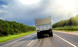 Truck on road. The back of a truck on a paved highway or road Royalty Free Stock Image