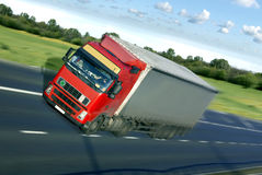 Truck on the road. Speed truck on the european road Royalty Free Stock Photography