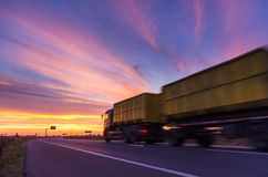 Truck on road. At sunset Stock Image