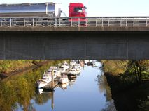 Truck on a road above a boat canal. In Oldenburg stock photography
