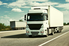 Truck on road, blue sky, cargo transportation concept, yellow toned Royalty Free Stock Images