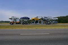 Truck on the road with colorful cars transport Royalty Free Stock Photography
