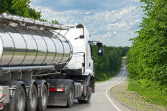 Truck on the road. Container on the big highway. transport loads Stock Photo