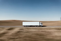 Truck on the road. 3D render on photographic background Stock Photos