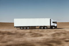 Truck on the road. 3D render on photographic background Royalty Free Stock Photo
