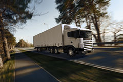 Truck on the road. 3D render on photographic background Royalty Free Stock Image