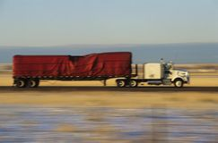Truck on road in desert Stock Photos