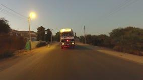Truck on the road in desert, Egypt. ASWAN, EGYPT - FEBRUARY 7, 2016: Truck on the road in desert, Egypt stock video footage