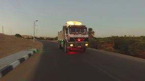 Truck on the road in desert, Egypt. ASWAN, EGYPT - FEBRUARY 7, 2016: Truck on the road in desert, Egypt stock video