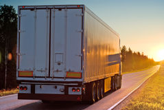 Truck on road in the evening. Truck on wood road in the evening Royalty Free Stock Image
