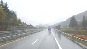 Truck on the road. Front view of the highway from the cabin of the transport truck stock video footage