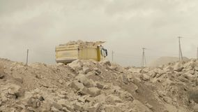 Truck on a road in quarry carring stones. Truck carring stones on a road in a quarry stock footage