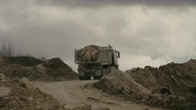 Truck on a road in quarry carring stones. High angle view of a truck carring stones on a road in a quarry stock footage