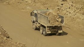 Truck on a road in quarry carring stones. Top view of a truck carring stones on a road in a quarry stock footage