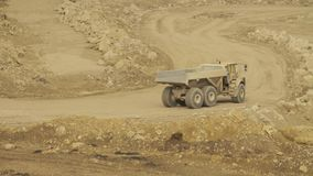 Truck on a road in quarry. Day country side, dirt road driving stock footage
