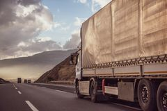 Truck on the Road in a Rural Landscape at Sunset.. Logistics Transportation and Cargo Freight Transport. Truck on the Road in a Rural Landscape at Sunset royalty free stock image
