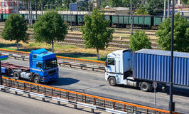 Truck on road in sea port, industrial infrastructure and railroad, cargo transportation, delivery and shipping concept Royalty Free Stock Images