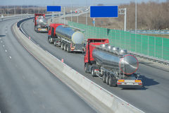 Truck on the road. From stainless steel on the highway. Working visitTank truck Stock Photos