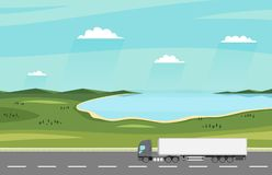 Truck on the road. Summer rural landscape with lake. Heavy trailer truck. Logistic and delivery concept. Royalty Free Stock Images