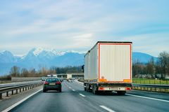 Truck on road Trucker on highway Lorry doing logistics work. Truck on road. Trucker on highway. Lorry doing logistics work. Semi trailer with driver. Big cargo royalty free stock image