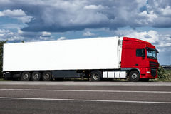 Truck on road with white blank container, blue sky, cargo transportation concept stock images