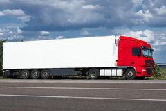 Truck on road with white blank container, blue sky, cargo transportation concept Stock Image