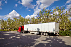 Truck on road with white blank container, blue sky, cargo transportation concept Royalty Free Stock Photo