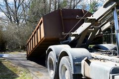 Truck roll-off dumpster stock photography