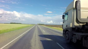 Truck on the route of Altai Krai. Altai Republic, Russia - July 14, 2015: Truck on the route of the Altai Krai stock video