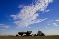 Truck is running on the freeway of the country side in America. America is a continent where American mainly live. In September Un. Ited States of America stock photography