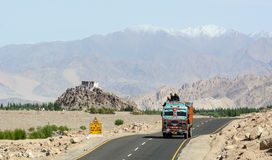 A truck running on the mountain road in Ladakh, India Stock Photo