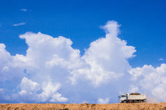 The truck running on sand soil. Royalty Free Stock Photo
