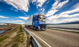 Truck rushes down the highway in the background Atlantic Ocean R. Oad Norway. Truck Car in motion blur stock photography