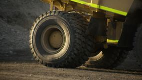 A truck`s wheel in slow motion. A medium shot of a truck`s wheel in slow motion. Camera tracks the truck`s wheel stock video footage
