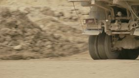 Truck`s wheels on a dirt road. Close up of a truck`s wheels driving on a dirt road, then rear view of the truck stock video footage