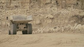 Truck`s wheels on a dirt road. Close up of a truck`s wheels driving on a dirt road, then rear view of the truck stock footage