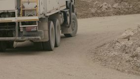 Truck`s wheels driving on a dirt road. Close up of a truck`s wheels driving on a dirt road stock video footage