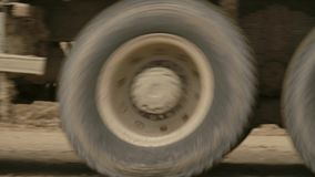 Truck`s wheels driving on a dirt road stock video