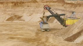 Truck in the sandy quarry. Loading a truck in the sandy quarry stock footage