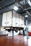 Truck service in garage, lifted lorry diagnostics Royalty Free Stock Image
