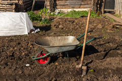 Truck and shovel in the garden Royalty Free Stock Photos