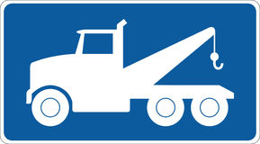 Truck sign. Blue interstate sign with a white towing truck Stock Photo