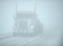 Truck in snow white-out, Dalton Highway, Alaska Stock Images