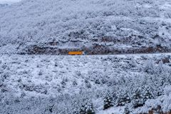 Truck in a snow covered mountain scene stock images