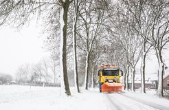Truck with snowplow, winter service stock image