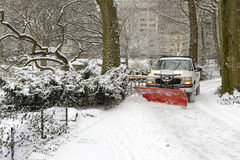 Truck snowplowing road after snowstorm Stock Image